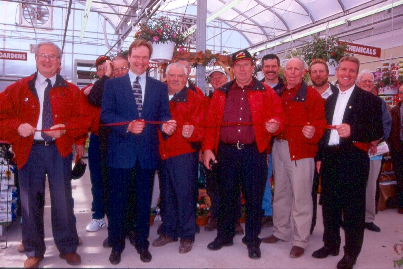North Wellington Co-op garden centre openings further showed the co-op's leadership. Pictured is the ribbon cutting for the Harriston Garden Centre Grand Opening in 2002.